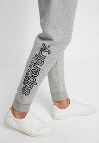 Superdry - INTERNATIONAL APPLIQUE JOGGER - Pantalones deportivos - silver glass feeder - 3