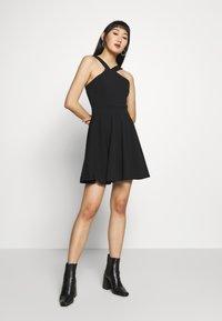 WAL G. - CRISS CROSS NECK SKATER DRESS - Sukienka koktajlowa - black - 1