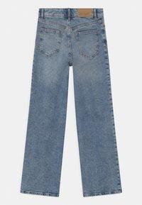 Lindex - TROUSERS LALEH - Bootcut jeans - blue denim - 1