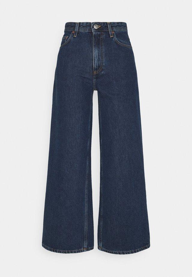 KIRI  - Flared jeans - stone blue