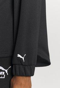 Puma - TRAIN LOGO ULTRA JACKET - Training jacket - black/white - 4