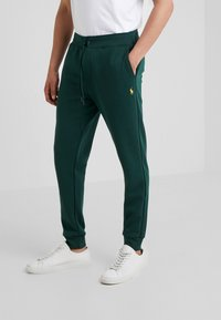 Polo Ralph Lauren - Tracksuit bottoms - college green - 0