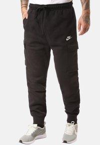 Nike Sportswear - CLUB PANT - Pantalones cargo - black - 0