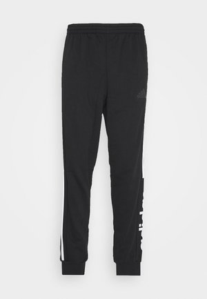 ESSENTIALS TRAINING SPORTS PANTS - Verryttelyhousut - black/white