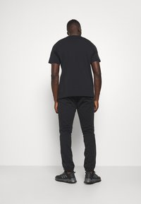 adidas Performance - PANT - Tracksuit bottoms - black - 2