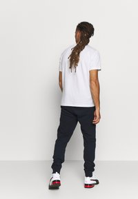 Champion - CUFF PANTS - Verryttelyhousut - navy - 2