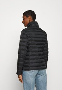 Calvin Klein - COATED ZIP LIGHT JACKET - Down jacket - black - 3