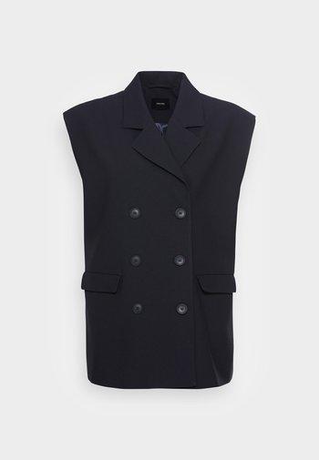 NESTE - Waistcoat - global blue