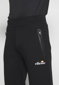 Ellesse - OSTERIA - Tracksuit bottoms - black - 5