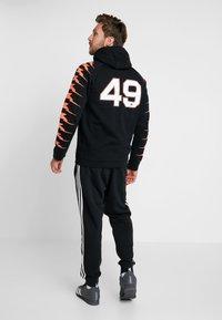 adidas Performance - Jersey con capucha - black - 2