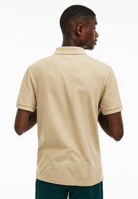 Lacoste - Polo shirt - beige - 1