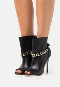Guess - ADINE - High heeled ankle boots - black - 0