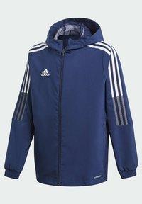 adidas Performance - GIACCA A VENTO TIRO 21 - Sports jacket - blue - 1