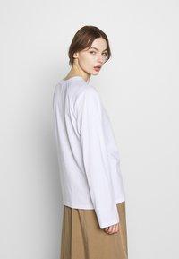 CALANDO - Long sleeved top - bright white - 2