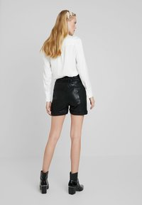 Cream - VICTORIA - Leather trousers - pitch black - 2