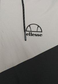 Ellesse - ZELBIA TRACK SUIT - Tuta - black - 6