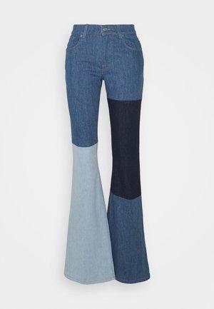 INDIGO SHADES - Flared jeans - blue