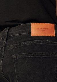 sandro - SLIM - Slim fit jeans - black denim - 4