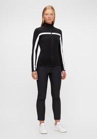 J.LINDEBERG - JANICE  - Training jacket - black - 1