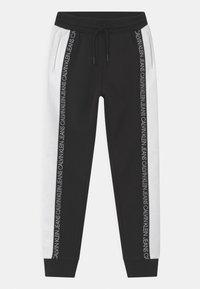 Calvin Klein Jeans - COLOUR BLOCK  - Pantalones deportivos - black - 0