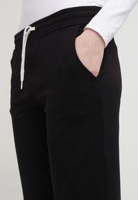 Zalando Essentials - Pantaloni sportivi - black - 4