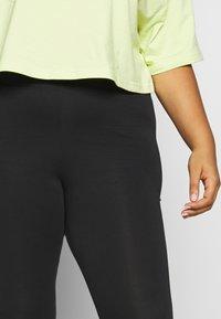 Nike Sportswear - LEGASEE PLUS - Leggings - black/white - 4