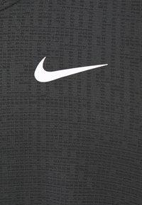 Nike Performance - T-paita - dark smoke grey/black - 4
