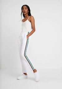 Urban Classics - DAMEN LADIES SIDE TAPED TRACK PANTS - Tracksuit bottoms - white - 1