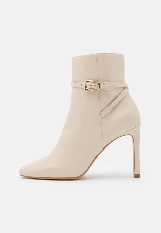 ROZANA - High heeled ankle boots - creme