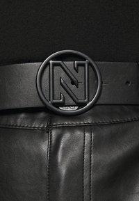 NIKKIE - MELLA PANTS - Trousers - black - 6