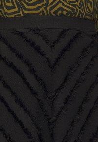 Proenza Schouler White Label - FRINGE FIL COUPE SKIRT - A-line skirt - black - 6