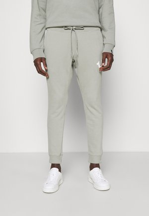 PANT CELESTIAL - Tracksuit bottoms - shadow green