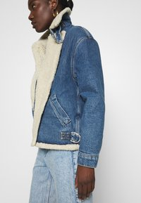 Calvin Klein Jeans - MOTO JACKET - Denim jacket - mid blue