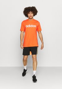 adidas Performance - Camiseta estampada - true orange - 1