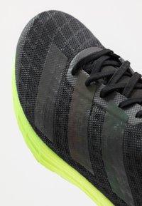 adidas Performance - ADIZERO BOUNCE SPORTS RUNNING SHOES - Zapatillas de competición - core black/signal green - 5
