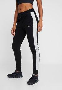 Fila - PANTS - Tracksuit bottoms - black/light grey melange - 0