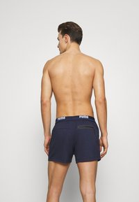 Puma - SWIM MEN LOGO LENGTH - Swimming shorts - navy - 1