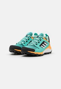 adidas Performance - TERREX AGRAVIC TR - Trainers - acid mint/footwear white/hazy orange