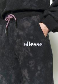 Ellesse - LORIOR - Tracksuit bottoms - dark grey - 4