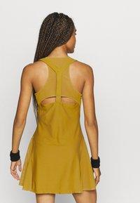 Nike Performance - MARIA DRESS - Sports dress - ochre/black - 2