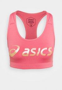 SAKURA SPIRAL BRA - Medium support sports bra - peach petal