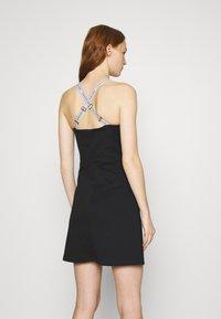 Calvin Klein Jeans - LOGO STRAPS MILANO DRESS - Žerzejové šaty - black - 2