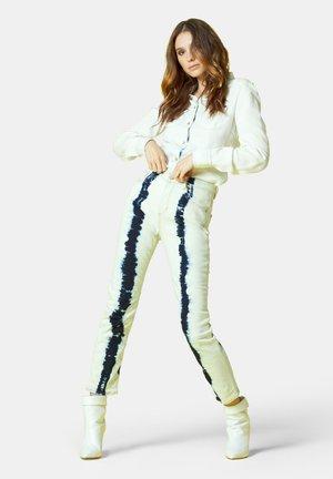 PER DONNA - Slim fit jeans - tie dye