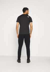 The North Face - DOOR TO TRAIL JOGGER  - Tygbyxor - black - 2