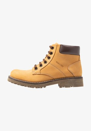 AXEL BOY - Botines con cordones - dark yellow