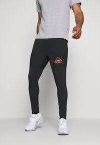 Nike Performance - PANT TRAIL - Verryttelyhousut - black/laser crimson - 0