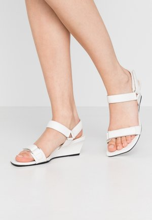 NELLIE - Wedge sandals - white