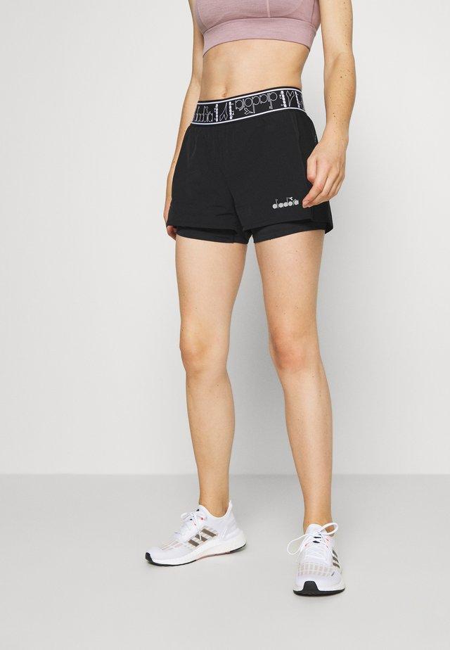 DOUBLE LAYER SHORTS - Pantalón corto de deporte - black