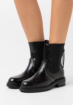 CECILIA - Classic ankle boots - black