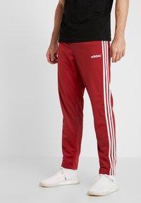 adidas Performance - 3 STRIPES SPORTS REGULAR PANTS - Träningsbyxor - red/white - 0